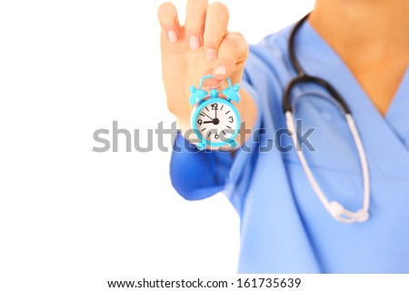 A picture of doctor's hand showing a clock over white background - stock photo