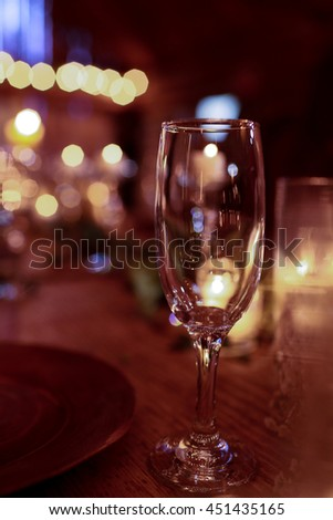 A picture of empty wineglass standing on the dinner table
