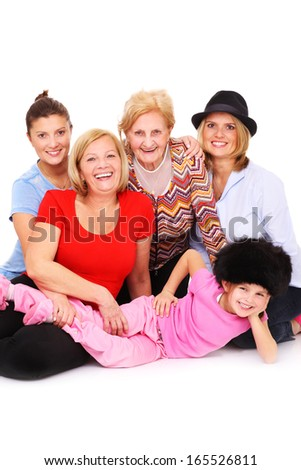 A picture of five women from the same family posing over white background - stock photo