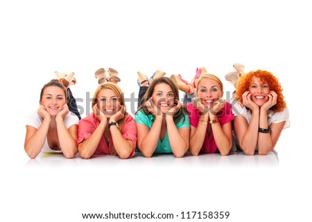 A picture of five women lying in a row and smiling over white background - stock photo