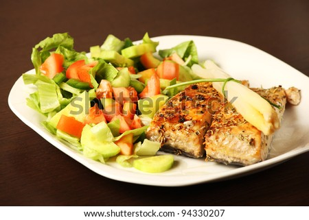 A picture of fresh salmon grilled with rosemary and served with salad and asparagus on side - stock photo