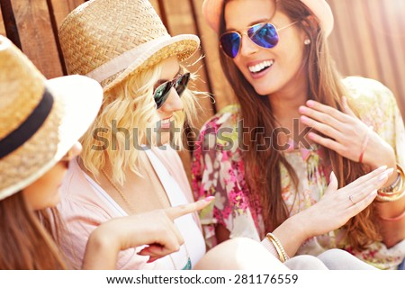 A picture of group of friends admiring engagement ring - stock photo