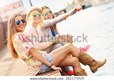 a picture of group of friends hanging out in the city - stock photo
