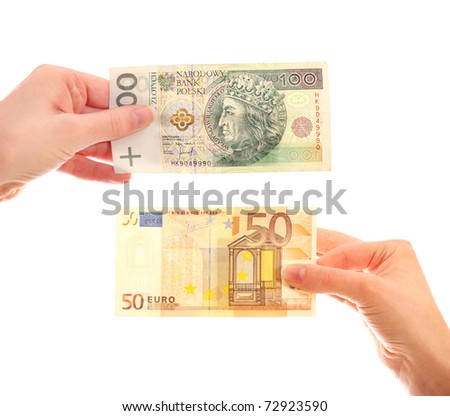 A picture of hands holding Polish hundred-zloty note and fifty-euro note over white background - stock photo