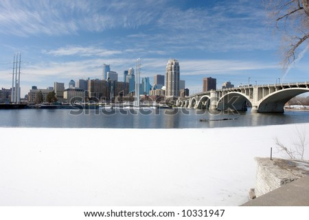 A picture of Minneapolis cityscape across icy river - stock photo