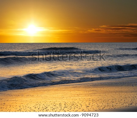 a picture of ocean water, sand and sun - stock photo