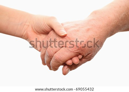 A picture of old and young hands symbolizing help and love