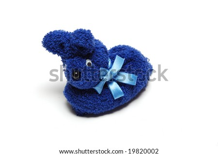 A picture of one blue stuffed rabbit