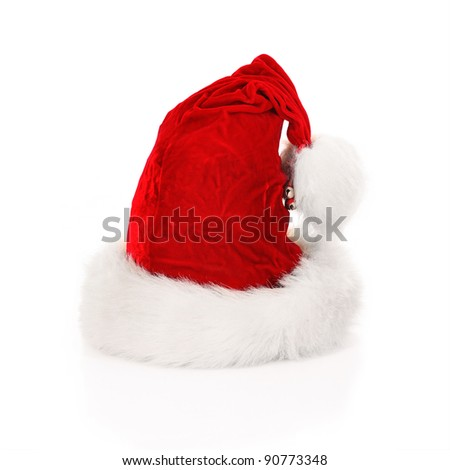 A picture of Santa's hat with small bells over white background - stock photo