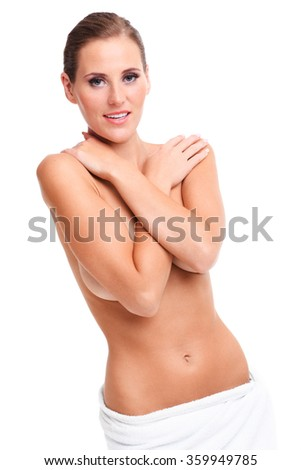 A picture of sensual naked woman with towel over white background