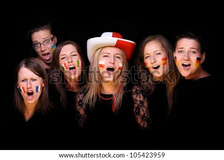 A picture of six young women with different flags on cheeks standing over black background - stock photo