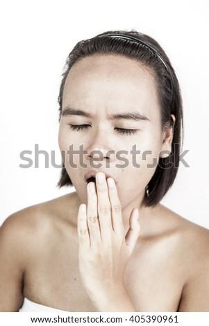 A picture of tan skin Asian women yawn. - stock photo