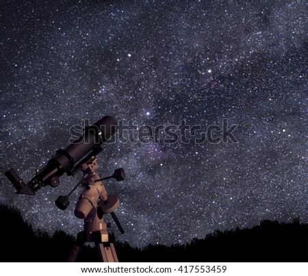 A picture of telescope pointed at the beautiful starry sky - stock photo