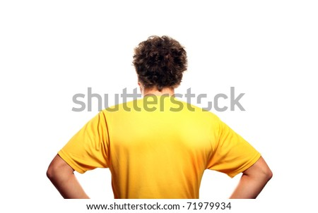 A picture of the back of a young man standing against white background