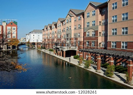 A picture of the canal in Indianapolis showing a hotel - stock photo