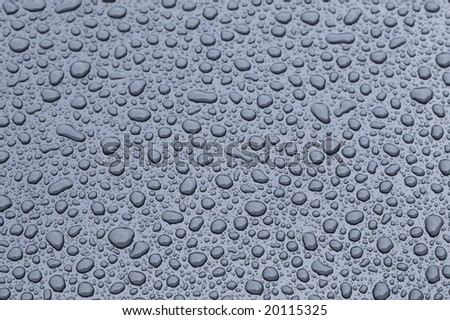 a picture of water drops on metal surface