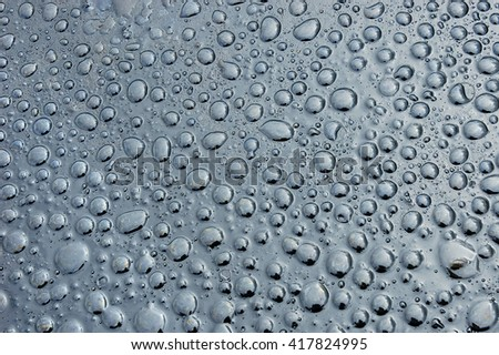 A picture of watter drops on the petroleum surface.