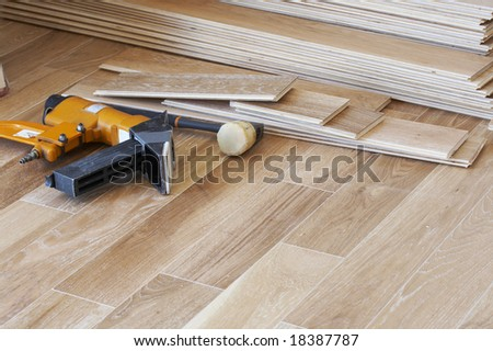 a picture of wood flooring and tools - stock photo