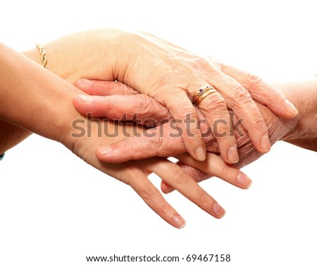 A picture of young and old hands against white background - stock photo