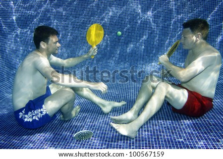 A picture two young men playing underwater
