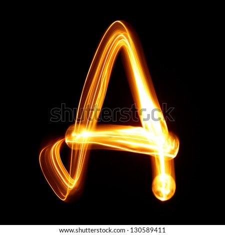 A- Pictured by light letters - stock photo
