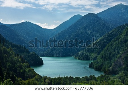 a picturesque lake ritsa in abkhazia - stock photo