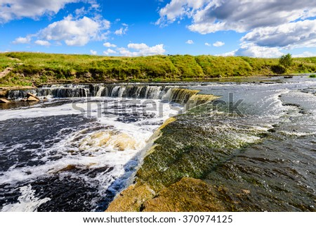A picturesque waterfall on the river Sablinka, Tosnensky district, Leningrad region, Russia.