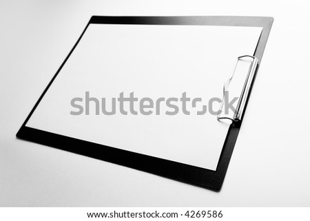 A piece of blank paper on clipboard