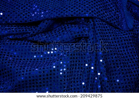 A piece of blue sequined fabric typically used to make dancer's costumes fills the image.  - stock photo