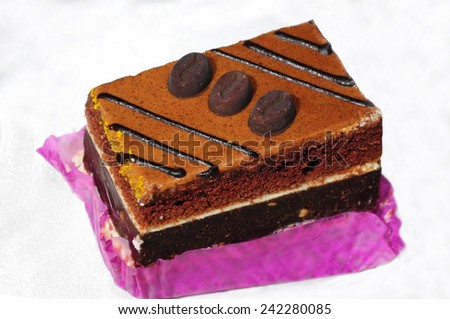 A piece of cake decorated with coffee beans  - stock photo