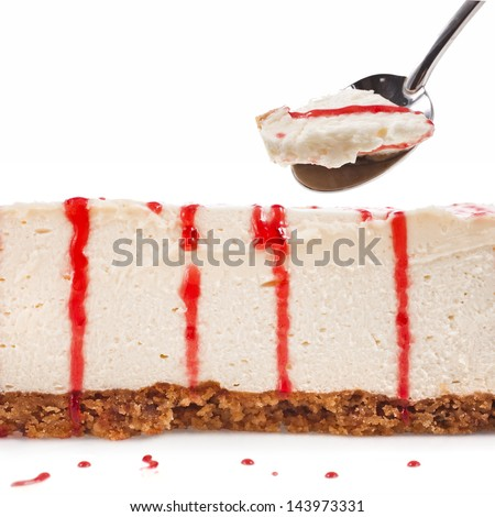 a piece of cake souffle in teaspoon close up isolated on white background - stock photo