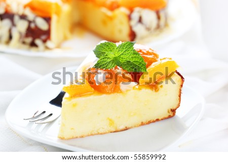 A piece of cake with apricot and almonds - stock photo