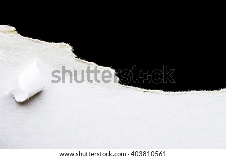 A piece of cardboard on the black background