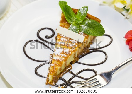 a piece of cheese cake on a table in a restaurant - stock photo