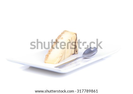 A piece of cheese cake on white background