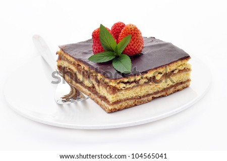 A piece of chocolate cake with mint and strawberry - stock photo