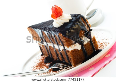 A piece of chocolate cake with vanilla cream - stock photo