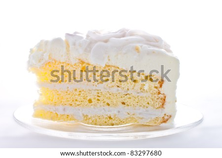 A piece of coconut cake on white background - stock photo