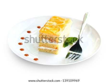 A piece of fruit cake with curd cream isolated on white background