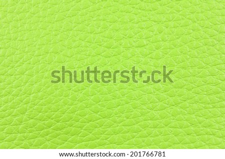 a piece of green natural leather, closeup, texture - stock photo