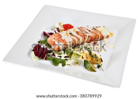 A piece of grilled salmon in cream sauce, with salad and rosemary, isolated on white background. - stock photo