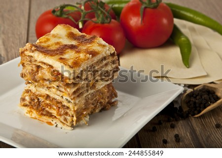 A Piece of Italian Lasagna Bolonese on a square plate