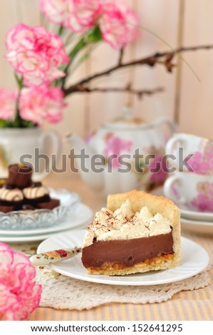 A piece of layered chocolate, salted peanut, caramel and whipped cream tart - stock photo