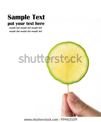 A piece of lime isolated on white background - stock photo