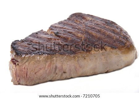 A piece of lovely fillet steak shot against a white background - stock photo