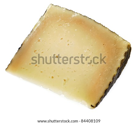 a piece of manchego cheese on a white background