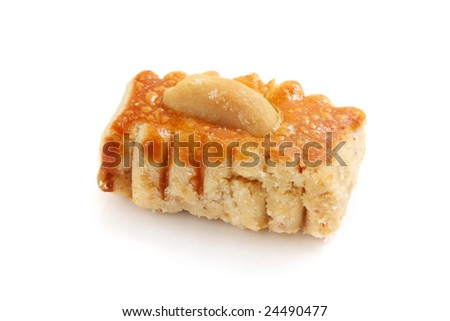 A piece of peanut cookie isolated over white background.