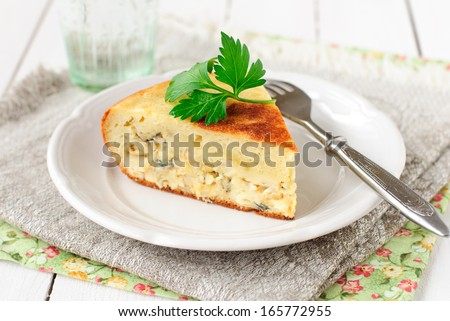 A Piece of Pie with White Fish and Onion Filling - stock photo