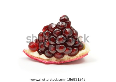 A piece of pomegranate fruit isolated on white.