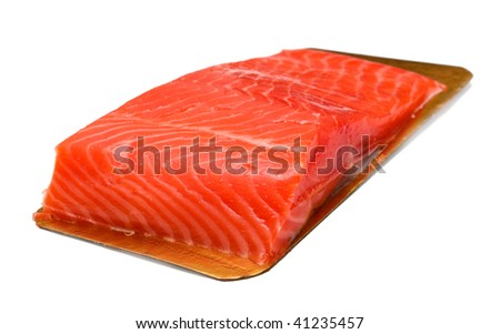 A piece of red fish on a board. Isolated on white. - stock photo